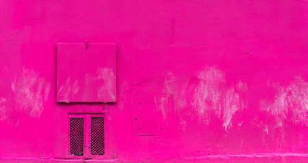 The pink wall and the small ventilation flap