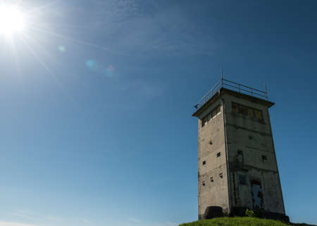 A ddr frontier tower in Thueringen with sunbeams