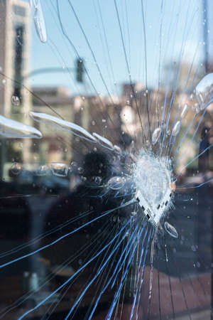 The cracked glass with a police mark in berlin
