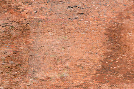 The old brick wall with many stones