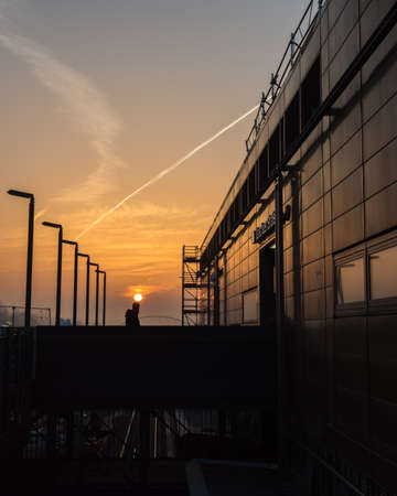 Germany, Berlin, February, 27-2019, A pedestrian at sunrise at the train station Warschauer Stra e in Berlin.