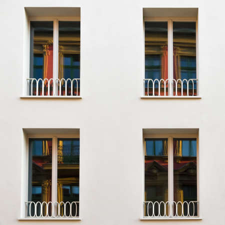 The four new windows with the old house as a reflection