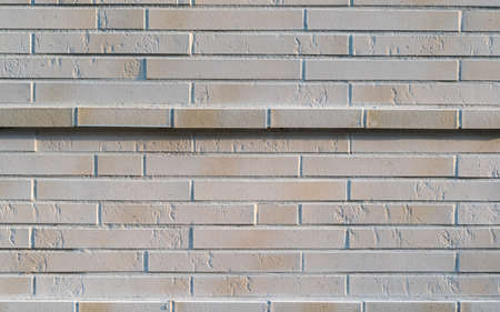 Solid new gray stone wall with a highlighted wall stripe 写真素材