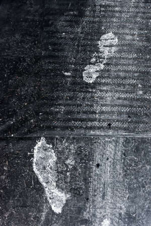 Two white footprints on the cover film after painting 写真素材