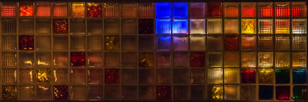 Colorful glass blocks glow in all colors at night 写真素材