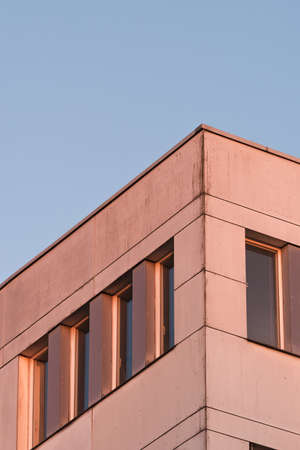 The corner of an old office building in the evening light