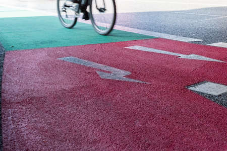 Cyclists on a red green bicycle lane in Berlin