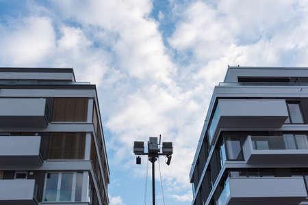 Camera surveillance between two modern new buildings 写真素材