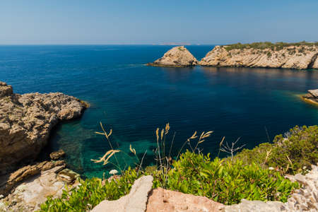 Cala vadella on ibiza from a cliff 写真素材