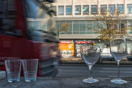 Truck in the city of Berlin with glasses in the foreground