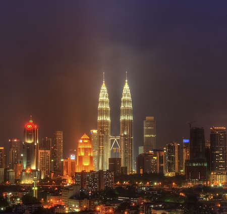 towers: Night View of Kuala Lumpur, Malaysia  Petronas Twin Tower and other skyscraper located around Kuala Lumpur City
