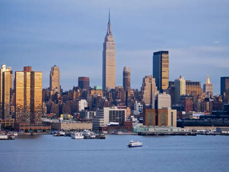 ny: This is a shot of the NY skyline as the sun sets. Stock Photo