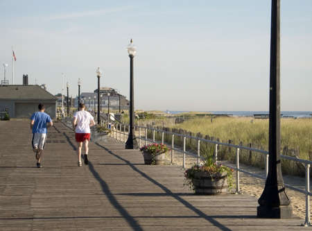A couple of runners on boardwalk in Ocean Grove NJ.