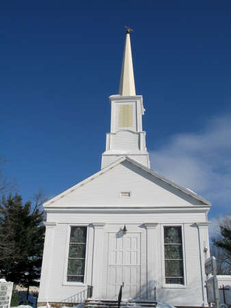 church steeple: This is a shot of an old wooden white church on a clear winters day