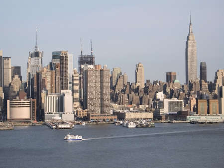 A current picture of New York's changing skyline showing new buildings with the cranes on top. Stock Photo - 394333