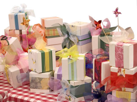 nicely: A group of nicely wrapped gifts on a white background.