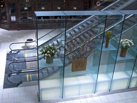 An escalator in a modern mall.