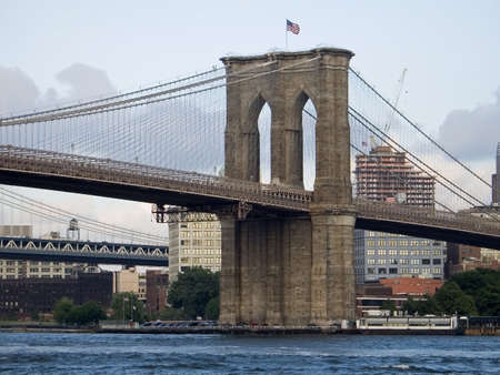 A nice view of the Brooklyn Bridge and the East River in lower Manhattan. photo