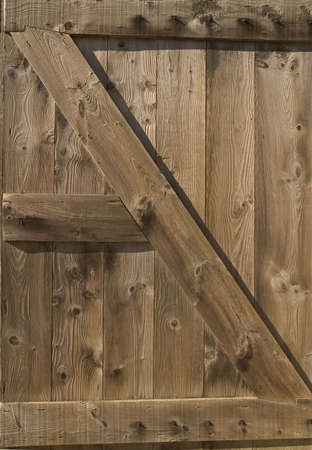 An old wooden shed door  showing nice texture and wood grain. Stock Photo - 632071