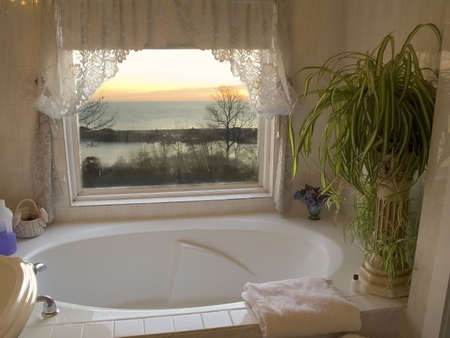 An oversized hot tub with a sunrise view of the ocean.