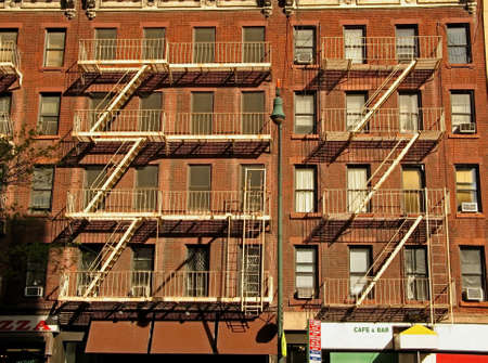 escapes: A shot of old fashioned fire escapes on New york Citys brownstone buildings.