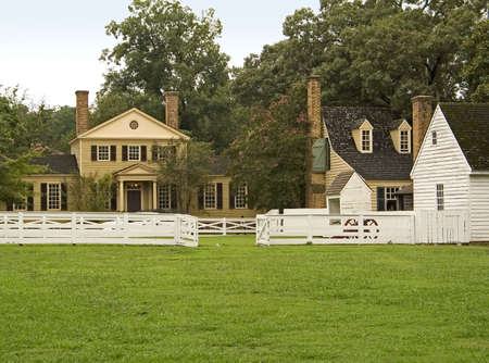 A group of old colonial buildings and green grass in historic Williamsburg virginia. 写真素材