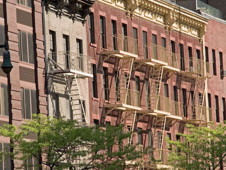 apartment: Some fire-escapes on old brick apartment buildings in Manhattan. Stock Photo
