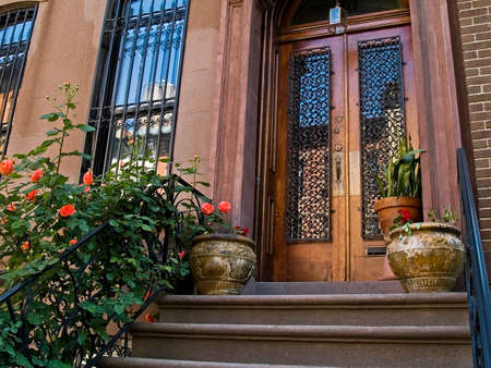 A front porch on an old New York City brownstone home.