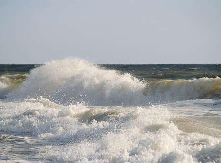 The power of a braking wave along the shoreline in Ocean City, Maryland.
