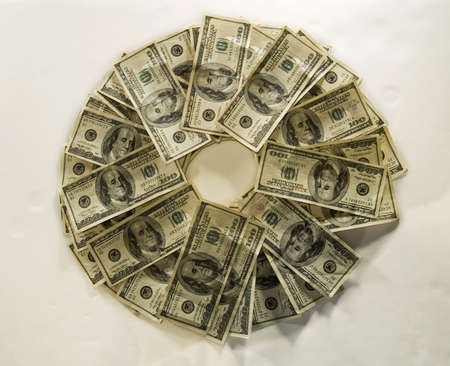 A circular pattern of 100 bills. 写真素材