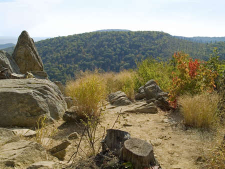 Rocks along Skyline Drive in Shenandoah National Park frame this scenic view. photo