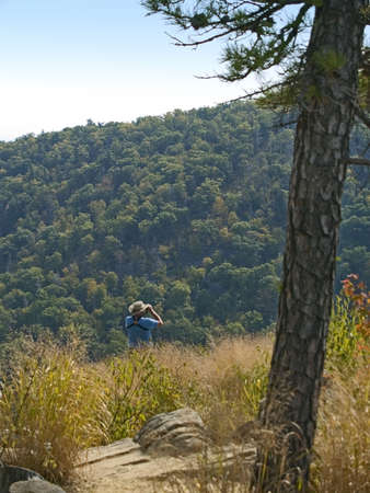 A hiker views the beautiful scene of the Blue Ridge Mountains in Shenandoah National Park in West Virginia. photo