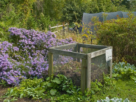 A example of a compost bin in an organic garden. Stock Photo
