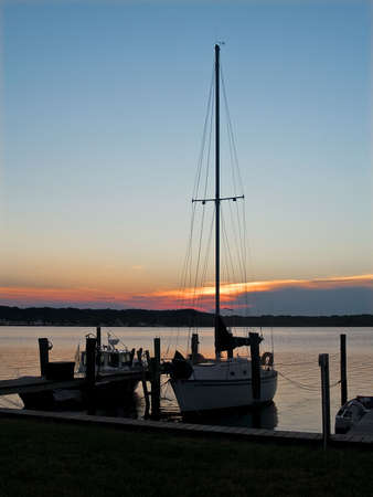 adds: A sailboat adds interest to this sunset photo at Seaview Island along the Jersey Shore.