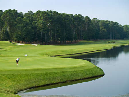 A golfer on the final hole at this beautiful Myrtle Beach golf course in South Carolina.