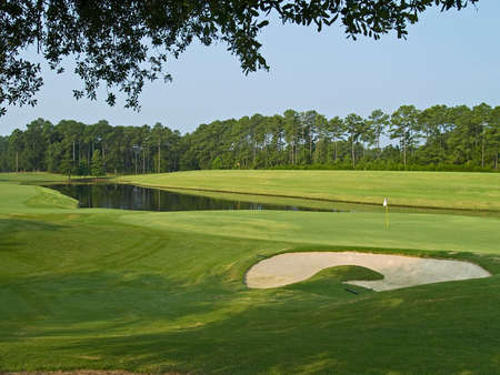 A sand trap and pond on this beautiful Myrtle Beach, South Carolina golf course. Stock Photo