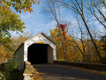 An Autumn view of the historic Loux Covered Bridge in rural Bucks County, Pennsylvania. photo