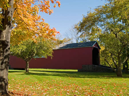 condemned: The historic Perkasie Covered Bridge in Bucks County, Pennsylvania was moved to a park to preserve it in 1958 after it had been condemned. Stock Photo
