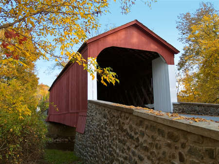 An Autumn view of the historic Van Sant Covered Bridge located in Bucks County, Pennsylvania.