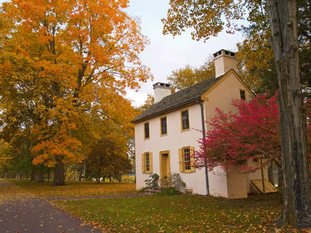 A colonial building in an Autumn setting at Washington Crossing State Park in Pennsylvania.