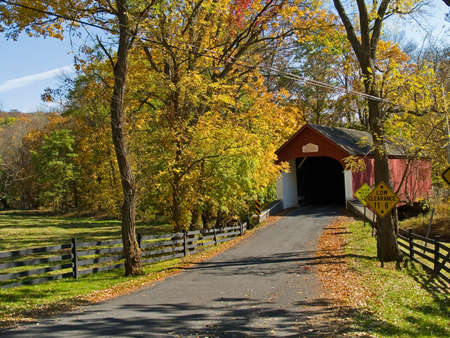 bridge in the forest: An Autumn view of the historic Knechts Covered Bridge in rural Bucks County, Pennsylvania.