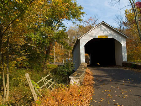 An Autumn  view of the Loux Covered Bridge located in Plumstead Township, Bucks County, Pa. Stock Photo - 3829541