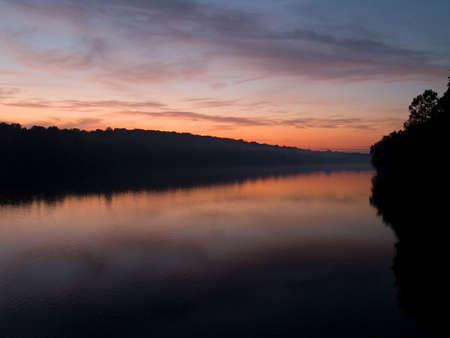 An early morning sunrise view of the Delaware River near Washing ton Crossing Stock Photo