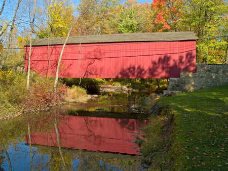 An Autumn view of the historic Pine Valley Covered Bridge located in Bucks County, Pennsylvania. photo