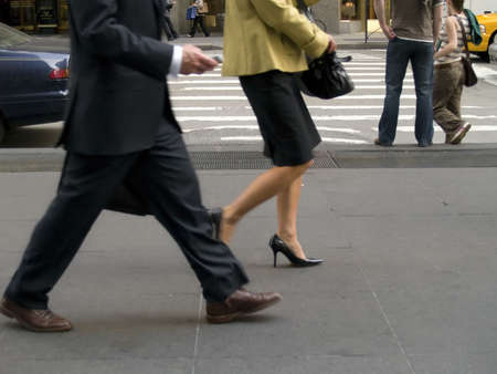 he: Business people on he move on the streets of Manhattan. Stock Photo