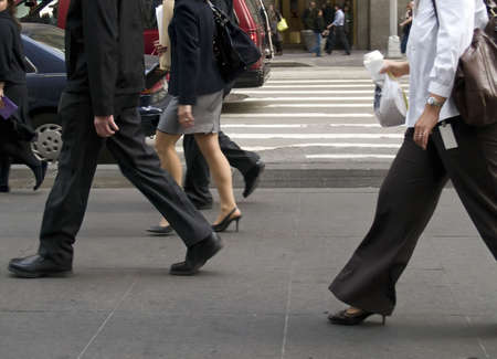 Business people on he move on the streets of Manhattan. photo