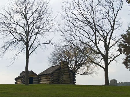 hillside: Historic log cabins on a hillside at Valley Forge National Historic Park in Pennsylvania. Stock Photo