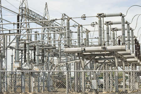 insulators: A view of electrical power plant equipment and cables.  Stock Photo