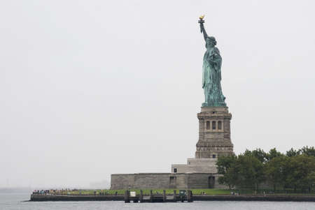 A wide angle view  of the Statue of Liberty in New York Harbor. photo