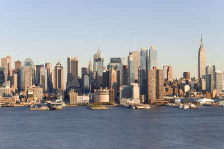 A daylight view of the New York City Skyline as seen from a cross the Hudson River in NJ.